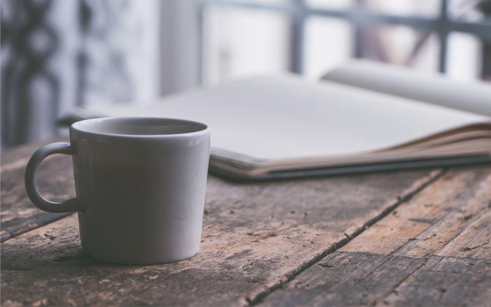 Heft Und Kaffeetasse